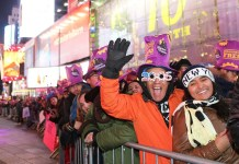 People take part in the New Year's Eve celebration at Times Square in New York, the United States, on Dec. 31, 2015. (Xinhua/Qin Lang)