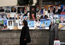 DAMASCUS, April 12, 2016 (Xinhua) -- Two Syrian women walk by the posters of candidates for Syria's parliamentarian elections in Damascus, capital of Syria, on April 12, 2016. (Xinhua/Ammar)