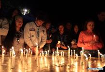 QUITO, April 24, 2016 (Xinhua) -- People holding candles attend the memorial event for the earthquake victims in Quito, capital of Ecuador, April 23, 2016. The death toll of the deadly 7.8-magnitude earthquake that struck the northern Pacific coast of Ecuador on April 16 has risen to 646, said President Rafael Correa Saturday. (Xinhua/Santiago Armas)