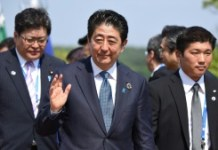 AFP/File / Toru Yamanaka Reports suggest Japanese Prime Minister Shinzo Abe (C) is likely to leave the tricky work of imposing heavier taxes -- a key measure which would help pay down one of the biggest debt loads among rich nations -- to his successor