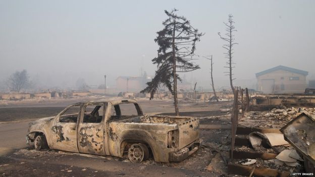 Images from inside the city show dozens of burned-out buildings
