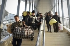 AFP/File / Wang Zhao Reports suggest Chinese authorities should accelerate reforms, allow migrant workers to settle in cities to expand demand, and further cut taxes