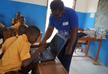 Primary 5 pupil touching the computer for the first time
