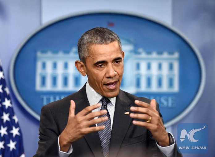 U.S. President Barack Obama speaks about the economy and corporate tax inversions in the Brady Press Briefing Room of the White House in Washington D.C., capital of the United States, April 5, 2016. (Xinhua/Yin Bogu)