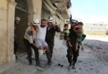 AFP / Ameer Alhalbi Syrian civil defence volunteers evacuate a man and children from a residential building following a reported air strike on Aleppo