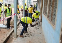 STAFF VOLUNTEERS PREPARING THE SITE FOR REFURBISHMENT AT MAMPONG SCHOOL FOR THE DEAF