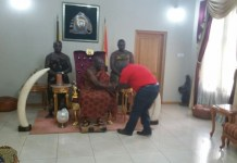 Ghana's Chief of Staff Julius Debrah in a hand shake with the Otumfuo