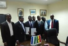 Executive Chairman Dr Joseph Siaw Agyepong third from right at the signing ceremony in Sierra Leone.