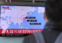 A man watches a TV news program reporting about North Korea's missile firing at Seoul Train Station in Seoul, South Korea, Monday, March 6, 2017. North Korea on Monday fired four banned ballistic missiles