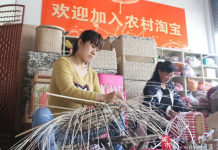 "Villagers of Wantou Village, Boxing county in east China's Shandong Province make crafts. The banner on the wall reads ""Welcome to join Taobao"". (Photo by official website of Boxing county)"