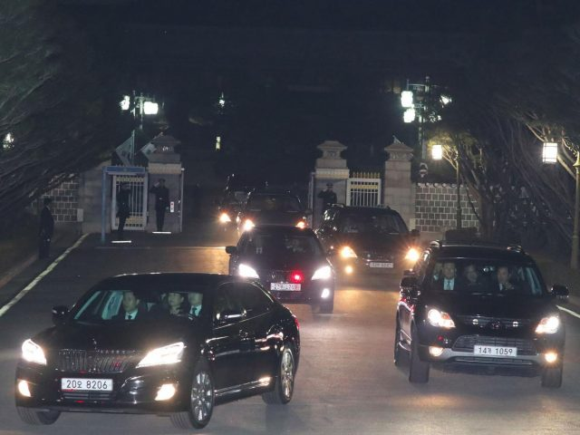 A car (L front) carrying South Korea's impeached ex-president Park Geun-Hye (C in the car) leaves the presidential Blue House in Seoul on 12 March, 2017 AFP/Getty Images