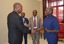 Justice Ore in the middle introduces Justice Matusses on the right to the President of Guinea Bissau on the left