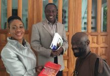 Prof. Kofi Kissi Dompere, seated right, with Mrs. Jean Mensa, Executive Director of the Institute of Economic Affairs (IEA) and Dr. Ransford Gyampo, Research Fellow (IEA).