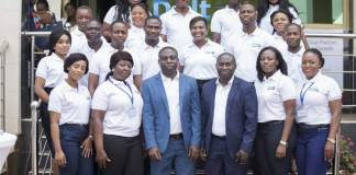 Mr Victor Owusu CEO of Delta Capital and Mr Samuel Asiedu Executive Director of Delta Capital flanked by staffs of Delta Capital
