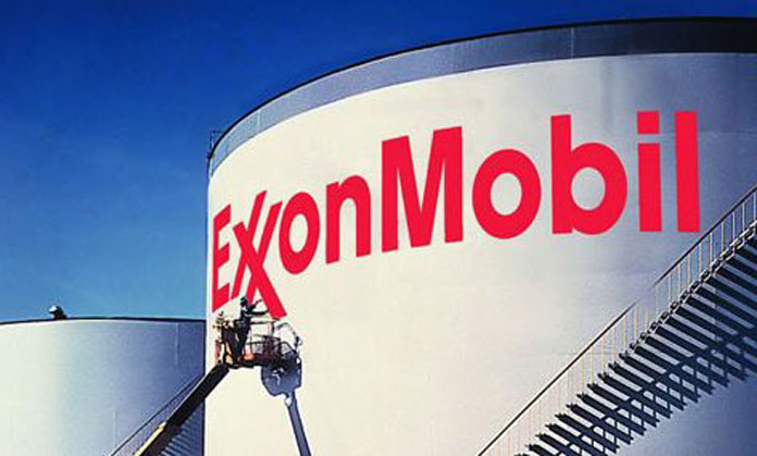 Oil giant Exxon announces major write-offs and job cuts