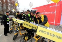 Shared electronic bikes are launched in Quanjiao county, Anhui province for local policemen to improve efficiency during rush hours on Dec. 6, 2017. (Photo by Shen Guo from CFP)