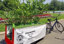 Photo Handout: Bike + Bike trailer with the trees for the Zayed Mile at Flushing Meadows Corona Park in Flushing, New York