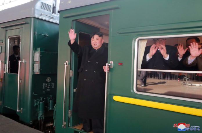 In this photo provided by the Korean Central News Agency (KCNA) on Feb. 24, 2019, Kim Jong Un, top leader of the Democratic People's Republic of Korea (DPRK), waves to senior officials who have come to see him off at Pyongyang Railway Station in Pyongyang, DPRK. Kim Jong Un left here Saturday afternoon by train for Vietnamese capital Hanoi for the second DPRK-U.S. summit, the official Korean Central News Agency (KCNA) reported Sunday. Kim will meet with U.S. President Donald Trump there on Feb. 27-28. Their first meeting was held in June 2018 in Singapore, which resulted in improved bilateral relations. Kim will pay an official visit to Vietnam at the invitation of Vietnamese President Nguyen Phu Trong before his meeting with Trump. (Xinhua/KCNA)