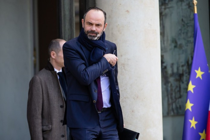 French Prime Minister Edouard Philippe (Front) leaves the Elysee Palace after a cabinet meeting on the COVID-19 in Paris, France, on Feb. 29, 2020. France has confirmed 73 cases of coronavirus infection by Saturday noon and the government has decided to impose stricter measures to contain its spreading, Minister of Health Olivier Veran announced. (Photo by Aurelien Morissard/Xinhua)