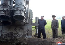 "Photo provided by Korean Central News Agency (KCNA) on Sept. 11, 2019 shows Kim Jong Un, top leader of the Democratic People's Republic of Korea (DPRK), again guiding a test-firing of ""super-large multiple rocket launcher"" on Sept. 10, 2019. (KCNA/Handout via Xinhua)"