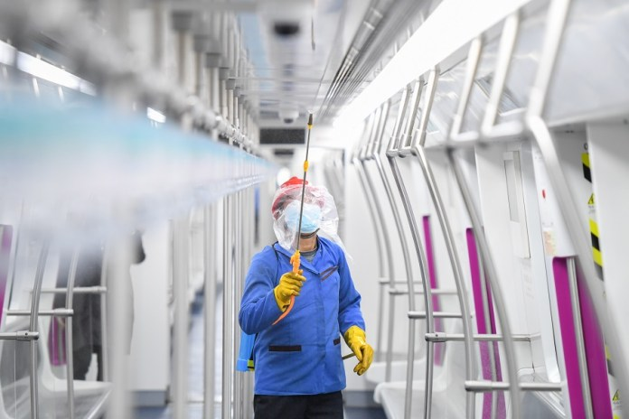 A staff member disinfects subway train carriage in Changsha, capital of central China's Hunan Province, Feb. 13, 2020. To ensure the safety of passengers, Changsha has stepped up various prevention measures at subway stations to curb the spread of the novel coronavirus, such as disinfection in subway stations and subway train carriages, temperature measuring, setting up new observation points and publicity of epidemic prevention information. (Xinhua/Chen Zeguo)