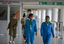 People wear protective face masks at Bole International airport in Addis Ababa, capital of Ethiopia, Jan. 30, 2020. (Xinhua/Michael Tewelde)