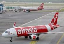 [Reuters]AirAsia planes are seen on the tarmac of Kuala Lumpur International Airport 2 (KLIA2) in Sepang
