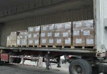 30 boxes of donated medical supplies sent to Tehran's hospitals delivered on the way from Shanghai (Photo: Courtesy of Li Hong)