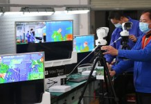 New type of thermo imaging system was tested in Xiangyang, Hubei Province. The system could check body temperature of 30-50 people simultaneously, which greatly improves the efficiency for fever screening in public places. Photo by Li Zhaoxu/People's Daily