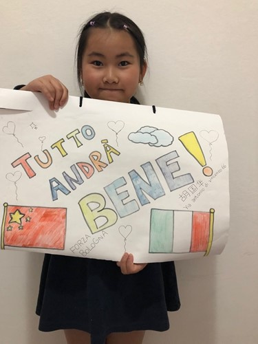 Hu Guohua, a Chinese child living in Bologna, shows her artwork. Photo: Courtesy of Chinese youth volunteers in Bologna