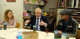 [Reuters]Prime Minister Boris Johnson visits a charity The Connection At St Martin's that supports rough sleepers in London
