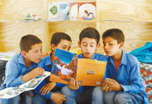 Afghan students read books at a mobile library in Kabul, capital of Afghanistan, July 2, 2019. File photo
