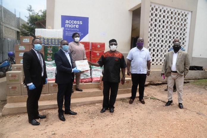 Nana Adu Keremateng Head Of Corporate Communications At Access Bank Presents Items To Albert Boakye Okyere Mce For Ashaiman