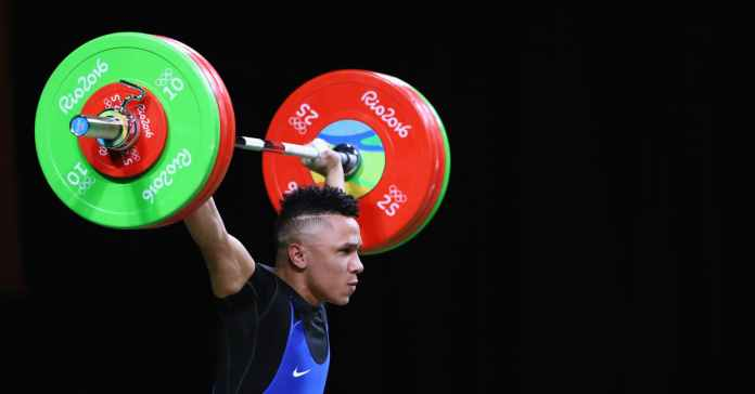 Luis Javier Mosquera Lozano of Colombia competes during the Men's 69kg Group A Weightlifting contest on Day 4 of the Rio 2016 Olympic Games.