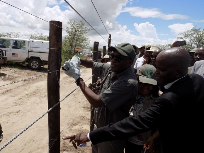 Namibia's Minister of Environment and Tourism Pohamba Shifeta (Front) takes part in the inauguration of Etosha National Park perimeter fence in Onanke area, northwestern Namibia, Feb. 22, 2020. The upgrade of the perimeter fence is crucial for the conservation of the Etosha area because it will assist in the reduction of human-wildlife conflict. The 824 km perimeter would include stock-proof fencing, game-proof fencing and cable fencing. (Xinhua/Musa C Kaseke)