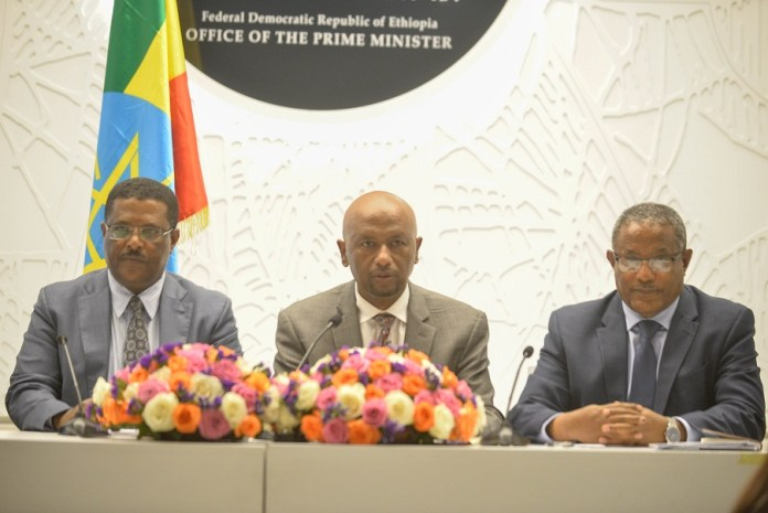 Press secretary at the office of the Prime Minister Nigusu Tilahun (L), Ethiopia's Minister of Water, Irrigation and Electricity Dr. Eng. Seleshi Bekele (C) and Minister of Foreign Affairs Gedu Andargachew attend a press conference in Addis Ababa, capital of Ethiopia, March 3, 2020. Ethiopia on Tuesday accused the United States of being