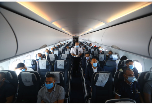 People wearing face masks are seen on an airplane from Cairo to Hurghada, Egypt, on June 18, 2020. Egypt reported on Thursday 1,218 new COVID-19 infections, bringing the total cases registered in the country since mid-February to 50,437, said Egyptian Health Ministry. (Xinhua/Ahmed Gomaa)