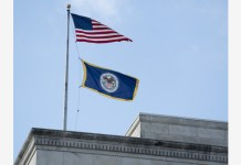 "WASHINGTON, March 3, 2020 (Xinhua) -- Photo taken on March 3, 2020 shows flags on the U.S. Federal Reserve building in Washington D.C., the United States. The U.S. Federal Reserve lowered the target range for the federal funds rate by 50 basis points to a range of 1.00 percent to 1.25 percent, as the novel coronavirus disease poses ""evolving risks"" to economic activity, the central bank announced Tuesday. (Xinhua/Liu Jie)"