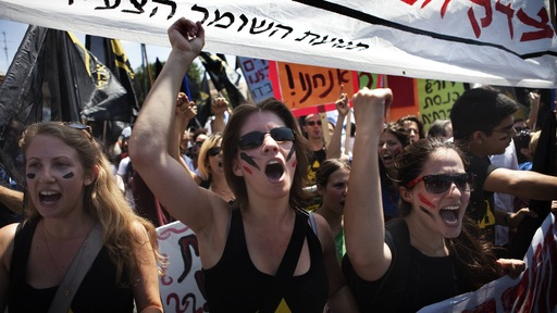 Protesters near Israeli parliament in Jerusalem. Photo by Menahem Kahana/AFP/Getty Images.