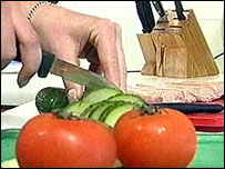 Image of salad being chopped