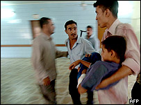 A boy injured in the blast is carried into hospital