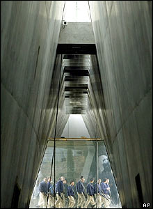 Israeli soldiers walk outside a new wing of the Yad Vashem Holocaust Memorial