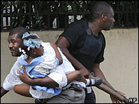 A man and his daughter flee violence in Haiti