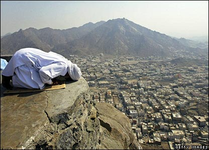 A pilgrim prays on top of Jabal al-Nur on the outskirts of Mecca