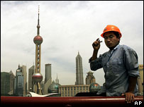 Construction worker and Shanghai skyline
