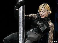 Madonna performs on a pole during her gig at the Olympic Stadium, Rome