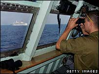 Israeli naval officer watches passenger ferry off Beirut - 18 July