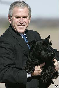 US President George W Bush and his dog Barney in Texas (26 December)