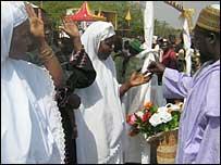 A man marrying three women exchange rings
