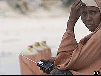 Somali woman listening to a radio